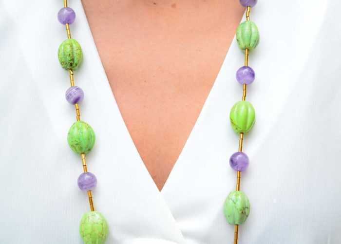 close up picture of a woman wearing an Amethyst Bead Necklace with Green Gaspeite Beads by Kiskadee Design