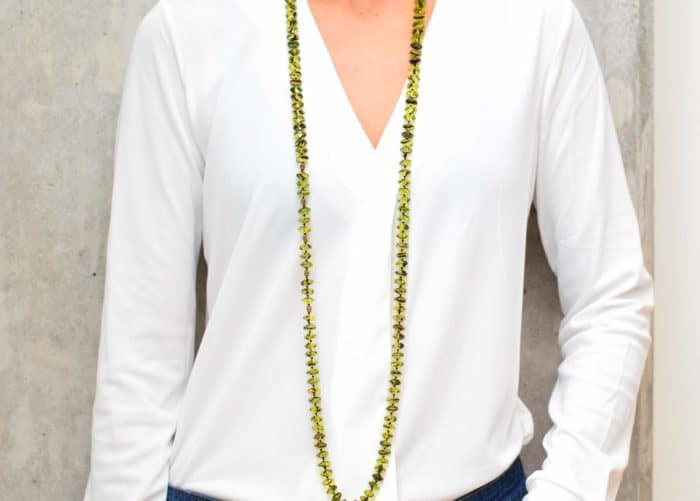 picture of a woman wearing a Green Agate Necklace with Gold Filled Accent Beads in a single strand by Kiskadee Design