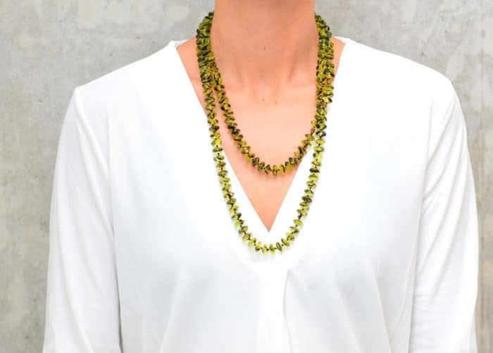 picture of a woman wearing a Green Agate Necklace with Gold Filled Accent Beads in double strand by Kiskadee Design
