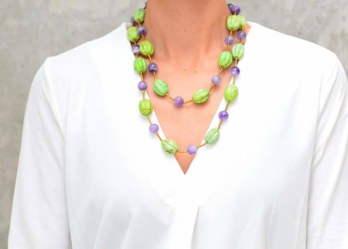 close up picture of a woman wearing a Gaspeite Necklace with Amethyst Beads by Kiskadee Design