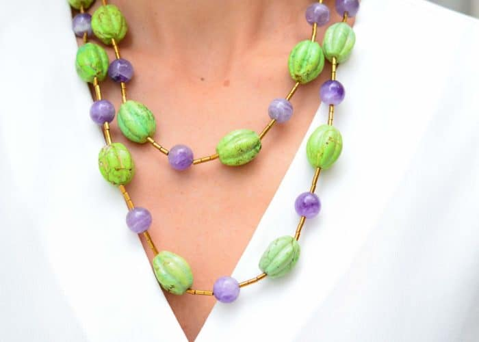 another close up picture of a woman wearing a Gaspeite Necklace with Amethyst Beads by Kiskadee Design
