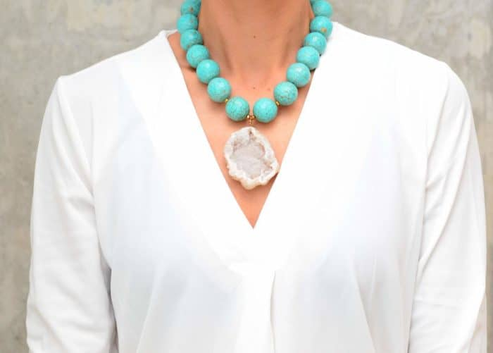 picture of a woman wearing a Turquoise Statement Necklace with Geode Pendant by Kiskadee Design