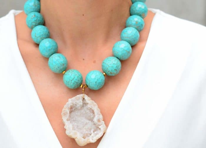 close up picture of a woman wearing a Turquoise Statement Necklace with Geode Pendant by Kiskadee Design