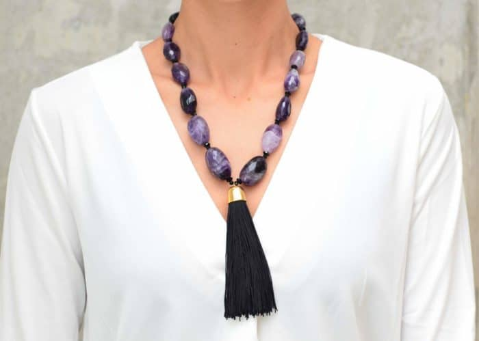 picture of a woman wearing a Tassel Pendant Necklace with Amethyst Beads by Kiskadee Design
