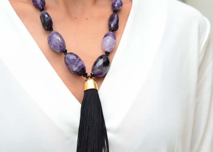 close up picture of a woman wearing a Tassel Pendant Necklace with Amethyst Beads by Kiskadee Design