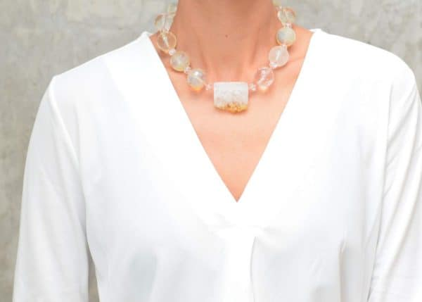 picture of a woman wearing a Citrine Quartz Necklace with Smoky Quartz Beads by Kiskadee Design