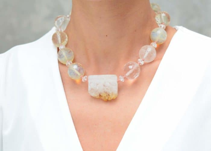 close up picture of a woman wearing a Citrine Quartz Necklace with Smoky Quartz Beads by Kiskadee Design
