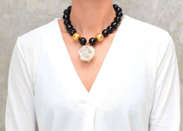 picture of a woman wearing a Druzy Geode Pendant on Black Onyx Necklace with Gold Filled Accent Beads by Kiskadee Design