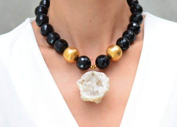 close up picture of a woman wearing a Druzy Geode Pendant on Black Onyx Necklace with Gold Filled Accent Beads by Kiskadee Design