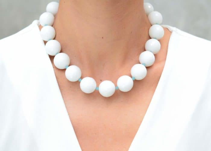 close up picture of a woman wearing a White Faceted Jasper Necklace by Kiskadee Design