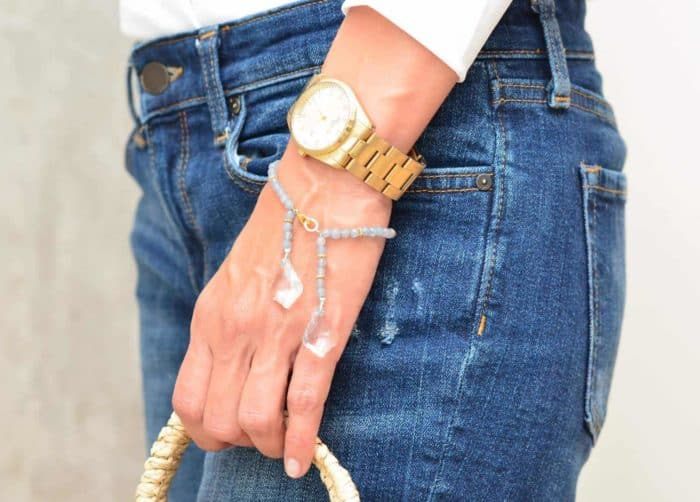 picture of a woman wearing an Agate Bead Bracelet with Crystal Accents by Kiskadee Design