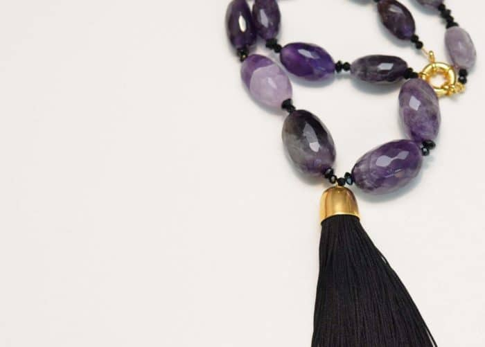 close up picture of a Tassel Pendant Necklace with Amethyst Beads on white background by Kiskadee Design