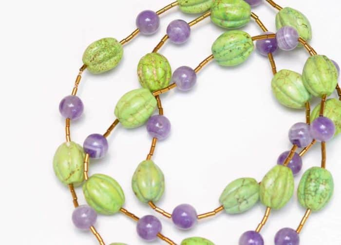 close up picture of a Gaspeite Necklace with Amethyst Beads on white background by Kiskadee Design