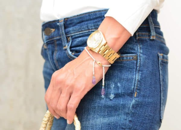 picture of a woman wearing an Amethyst Bracelet with Silver Beads by Kiskadee Design
