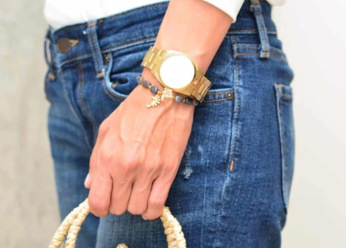 picture of a woman wearing a Labradorite Bead Bracelet with Sea Horse Charm by Kiskadee Design