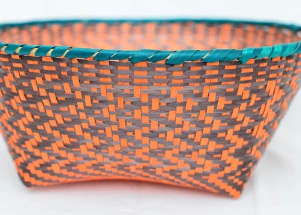 Close Up Product Image of colorful Bread Basket made of Paja Tetera with Aqua border, Orange and brown patterns