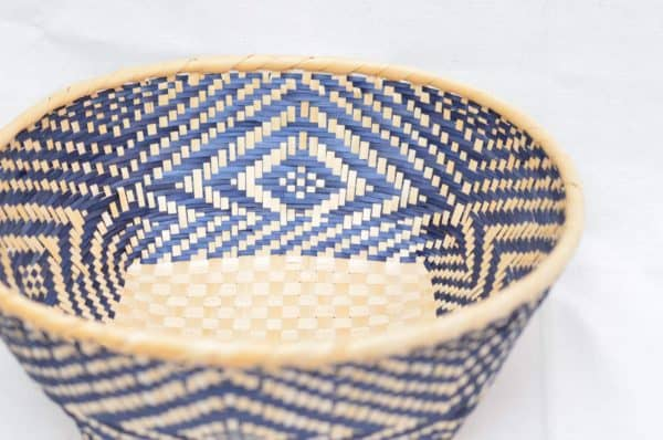 Main product image from the top of a small woven basket with white and blue pattern walls