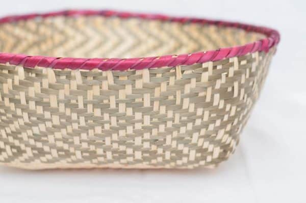 Close Up Product Image of colorful Bread Basket made of Paja Tetera with pink border and grey pattern