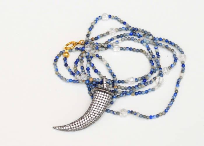 close up picture of a Lapis Lazuli Long Necklace with Fang Pendan on white background by Kiskadee Design