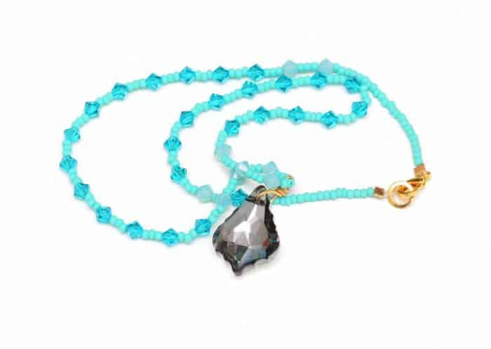 picture of a Turquoise Bead Necklace with Aquamarine Crystal Accents and Grey Crystal Pendant on white background by Kiskadee Design