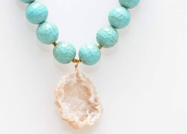 close up picture of a Turquoise Statement Necklace with Geode Pendant on white background by Kiskadee Design