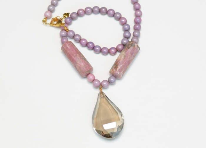 close up picture of a Lepidolite Necklace with tear-drop Grey Crystal Pendant on white background by Kiskadee Design