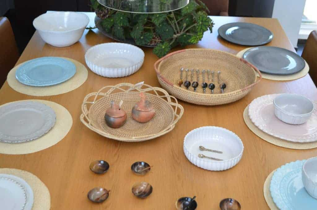 Picture of dinning table setting with various teaspoon made of mother of pearl and horn, and Clay Condiment Serving Chickens