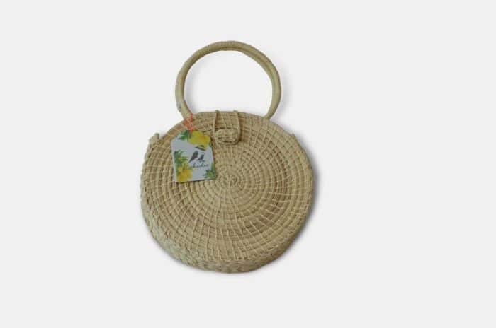 Main product image of a circle woven handbag with round handles handmade from Iraca Palm Fibers