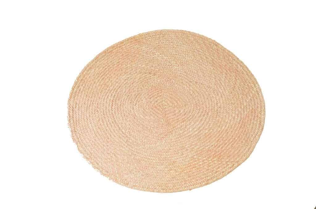 Main product image of pink round placemats woven in iraca fibers