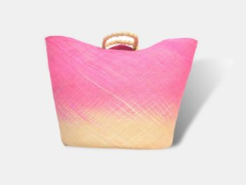 Main product image of a large pink woven basket with handles in iraca palm fibers