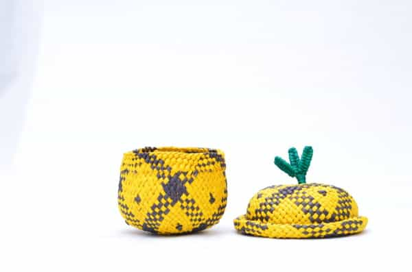 product picture of a tiny pineapple shaped basket woven from Iraca fibers with lid on the side