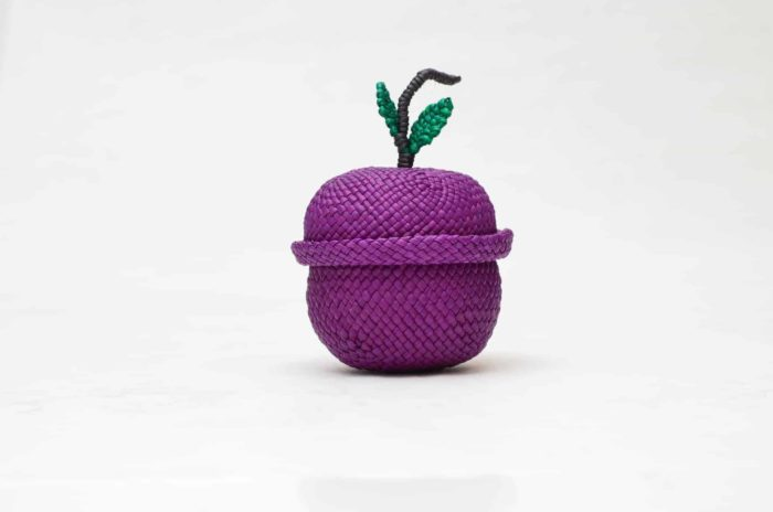 product picture of a tiny grape shaped basket woven from iraca fibers with its lid on