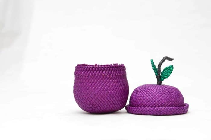 product picture of a tiny grape shaped basket woven from Iraca fibers with lid on the side
