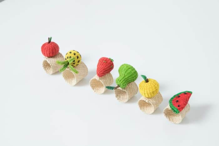 Kiskadee Design Catalogue Image of a Apple Lemon Pineapple Strawberry Pear and Watermelon Fruit Napkin Rings by the artisans in Sandona Narino