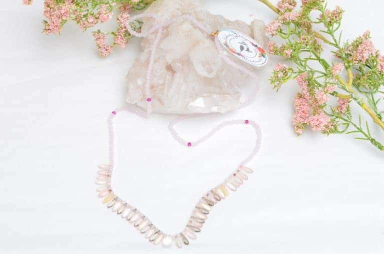 close up picture of a Pink Glass Bead Necklace with Pink and Grey Point Czech Bead Accents on white background decorated with flowers by Kiskadee Design