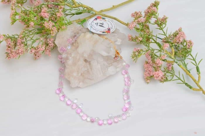 close up picture of a Pink and White Crystal Choker Necklace on white background decorated with flowers by Kiskadee Design