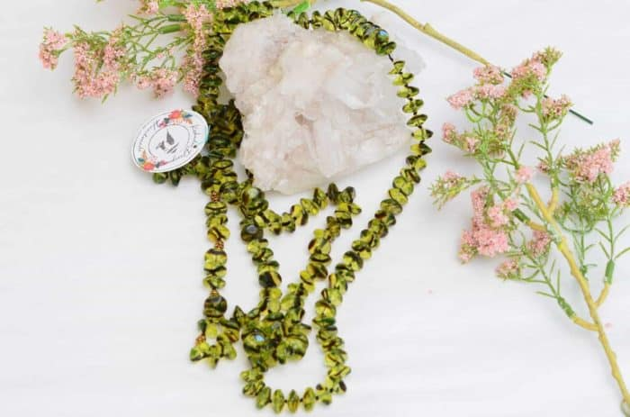 close up picture of a Green Agate Necklace with Gold Filled Accent Beads on white background decorated with flowers by Kiskadee Design