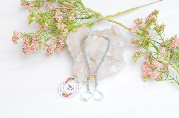 close up picture of an Agate Bead Bracelet with Crystal Accents on white background decorated with flowers by Kiskadee Design