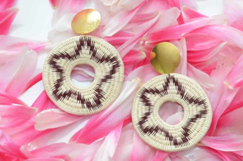 Close up picture of a pair of Werregue Woven Circle Earrings with Gold Stud on a rose petal backdrop