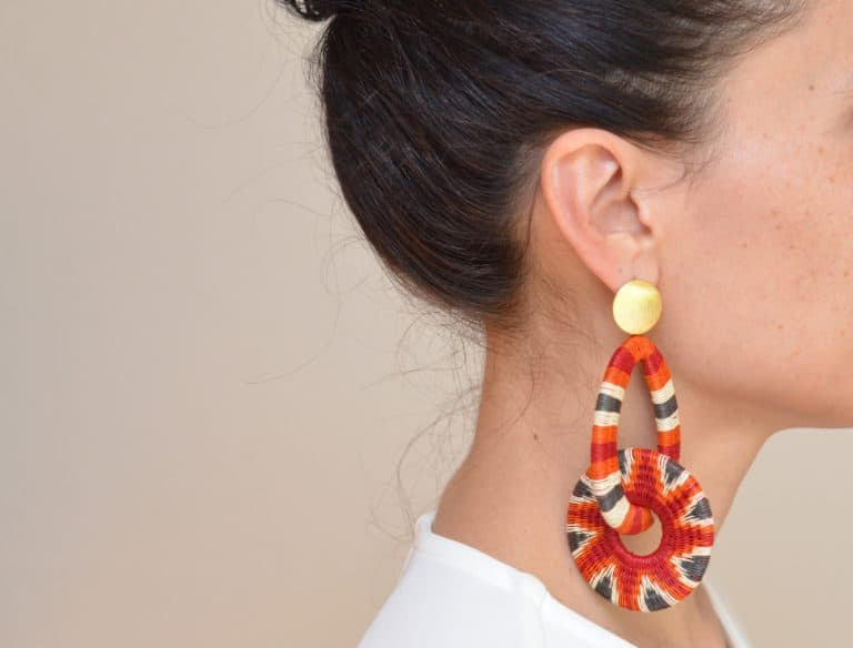 close up picture of a woman wearing a Werregue Woven Circle Earrings by Kiskadee Design