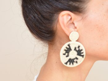 close up picture of a woman wearing a Werregue Double Circle Earrings by Kiskadee Design