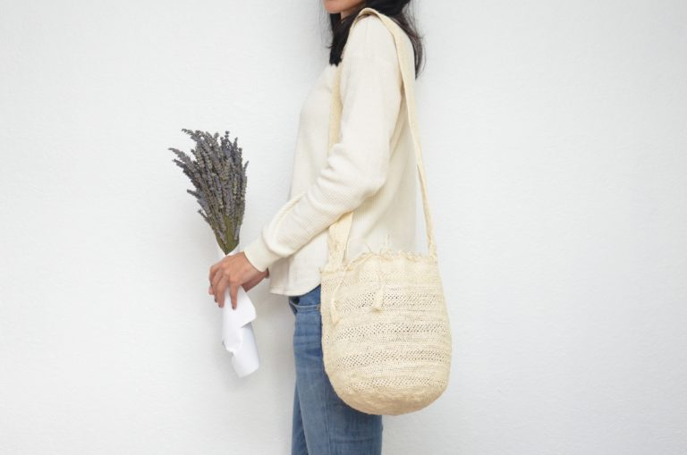 Kiskadee Design Image with Product being Used of a Colombian Mochila Bag in White Fique