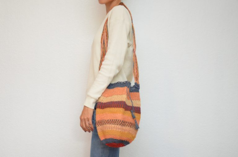 Kiskadee Design Image with Product being Used of a Atanquez Pattern Kankuamo Fique Mochila by Women of the Indigenous Tribe in the Sierra Nevada de Santa Marta - Colombia
