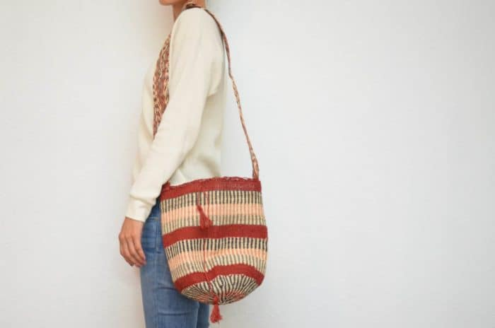 Kiskadee Design Image with Product being Used of a Rancho de la Goya Pattern Kankuamo Fique Mochila by Women of the Indigenous Tribe in the Sierra Nevada de Santa Marta - Colombia