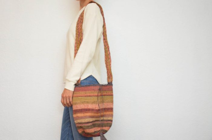 Kiskadee Design Image with Product being Used of a Guatapuri Pattern Kankuamo Fique Mochila by Women of the Indigenous Tribe in the Sierra Nevada de Santa Marta - Colombia
