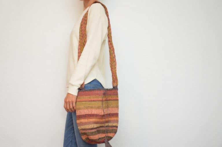Kiskadee Design Image with Product being Used of a Guatapuri Pattern Kankuamo Fique Mochila by Women of the Indigenous Tribe in the Sierra Nevada de Santa Marta - Colombia