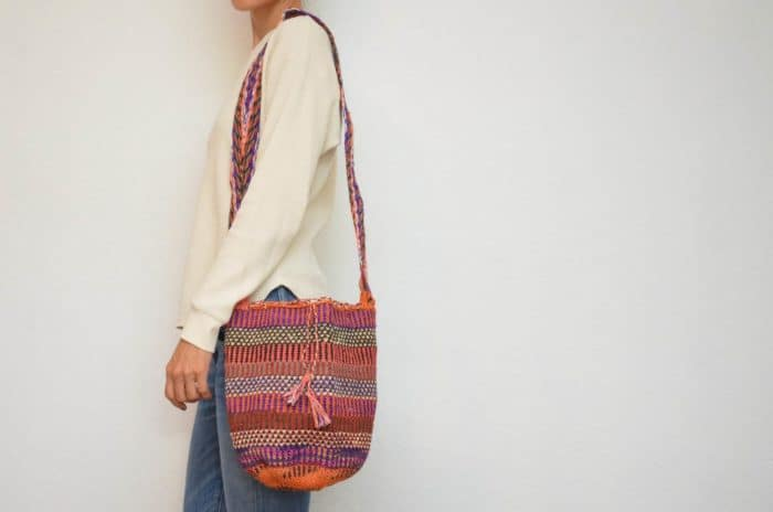 Kiskadee Design Image with Product being Used of a La Mina Pattern Boho Crossbody Bag by Women from the Kankuamo Indigenous Tribe in the Sierra Nevada de Santa Marta - Colombia