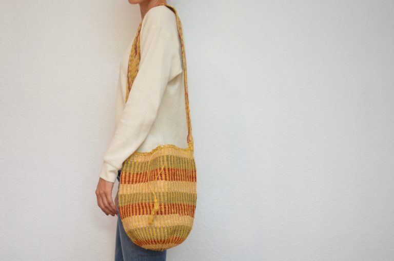 Kiskadee Design Image with Product being Used of a Las Flores Pattern Boho Crossbody Bag by Women from the Kankuamo Indigenous Tribe in the Sierra Nevada de Santa Marta - Colombia