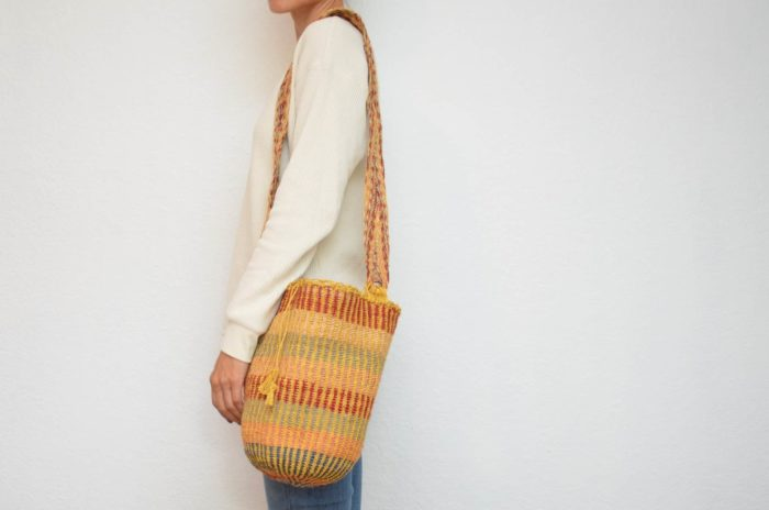 Kiskadee Design Image with Product being Used of a Mojao Pattern Handwoven Shoulder Bag by Women from the Kankuamo Indigenous Tribe in the Sierra Nevada de Santa Marta - Colombia