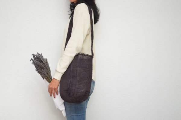 Kiskadee Design Image with Product being Used of a Black Colombian Crossbody Bag by Women from the Kankuamo Indigenous Tribe in the Sierra Nevada de Santa Marta - Colombia